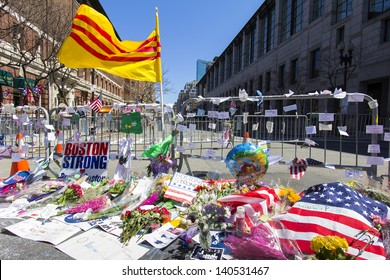 BOSTON, USA - APRIL 21: Locals and tourists left a lot of mementos and messages of courage at the several improvised memorials of the 2013 Boston Marathon bombing along Boylston st on April 21, 2013.