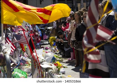 BOSTON, USA - APRIL 21: Locals and tourists visiting one of the several memorials of  the Boylston st to leave mementos and pray for the victims of the Boston Marathon 2013 bombing on April 21, 2013.
