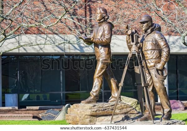 Boston, USA - April 24, 2017: Statue of  Brad Washburn and  Barbara Washburn, They built the Boston Museum of Science. Located near Boston Museum of Science, Boston, Massachusetts, USA.