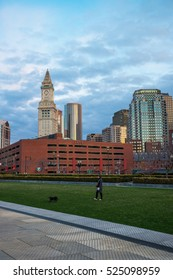 Boston, USA - April 27, 2015: Financial District and Custom House Tower at North End Park at Cross Street in Boston, Massachusetts, the United States. People on the background