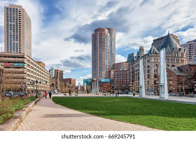 Boston, USA - April 28, 2015: Holocaust Memorial at Union Street Park and Skyscrapers in Congress Street in downtown Boston, MA, America. People on the background