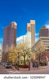 Boston, USA - April 29, 2015: Skyline with Skyscrapers in Congress Street in downtown Boston, MA, USA. People on the background