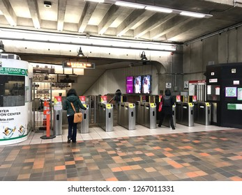 Boston, USA: Dec 12, 2018: Redline MBTA entry at Porter Station in Boston. Red Line is a rapid transit line.