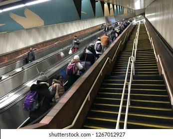 Boston, USA: Dec 12, 2018: Redline MBTA big escalator at Porter Station in Boston. Red Line is a rapid transit line.