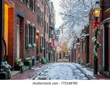 BOSTON, USA - DECEMBER 12: The historic architecture of the Acorn Street in Boston, Massachusetts, USA at sunrise showcasing its brick buildings and cobblestones at Beacon Hill on December 12, 2017.