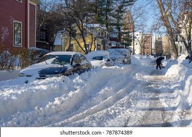 Boston, USA - January 5 2018: Parked cars covered in snow after a blizzard in the Greater Boston Area.