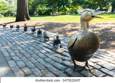 BOSTON, USA - JULY 11: Boston Public Garden with its famous duck family brass statues in Boston, Massachusetts, USA on a sunny summer day of July 11, 2019.