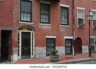 BOSTON, USA - JULY 25, 2018: The historic architecture of  Beacon Hill in Boston, Massachusetts, USA with its cobble stone street and brick buildings