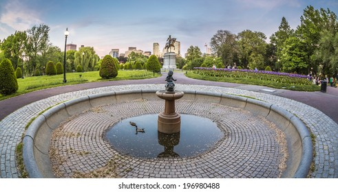 BOSTON, USA - JUNE 2: Panorama of the architecture of the Boston Public Garden in Boston, MA, USA with its gardens, the statue of Washington, and some locals enjoying the nice weather on June 2, 2014.
