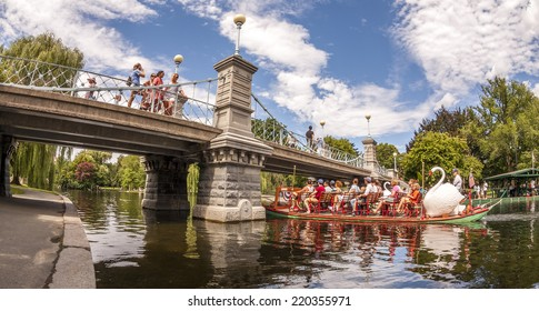 BOSTON, USA - JUNE 20, 2014: Panoramic view of Boston in MA, USA showcasing the architecture of the Boston Public Garden with some tourists going for a ride in the famous Swan Boats on June 20, 2014.