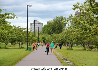 BOSTON, USA - JUNE 8, 2013: People visit Charles River esplanade park in Boston. Boston is the largest city in Massachusetts with urban area population of 4,180,000.