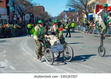 BOSTON, USA - Mar. 18, 2018: Artistic cycling in Saint Patrick's Day Parade in Boston, Massachusetts, USA.