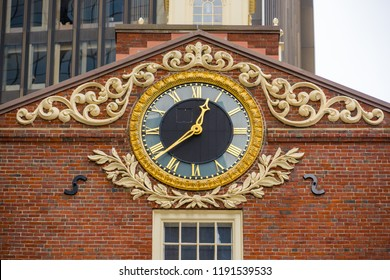 BOSTON, USA - MARCH 10, 2018: A beautiful clock adorns the facade of Old State House roof. There is the historic building in central Boston, Massachusetts, USA