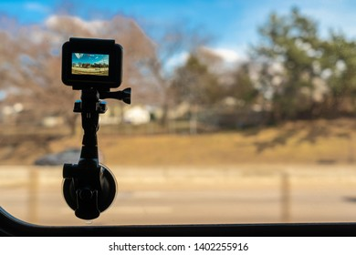 Boston, USA - MARCH 2019 : The Gopro hero 7 black Action camera taking the out side side nature and tree between travel by train on March 25, 2019 when traveling from  Philadelphai to Boston,
