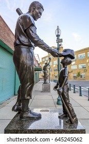 BOSTON, USA - MAY 10: statues of famous baseball payers in front of the histroric Fenway Park Stadium in Boston, MA, USA on May 10, 2017.