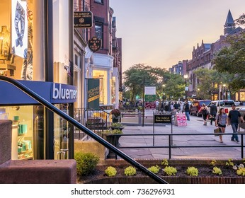 BOSTON, USA - OCTOBER 15, 2017: the famous Newbury Street in Boston, MA, USA at sunset with its expensive stores and restaurants with lots of locals and tourists shopping on October 15, 2017.