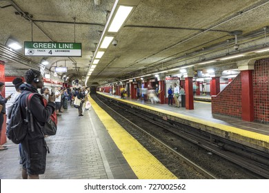 BOSTON, USA - SEP 12, 2017: people wait for the next Metro at green line station. The Boston Metro from 19th century is one of the oldest in the USA.