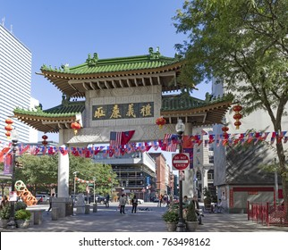 BOSTON, USA - SEP 29, 2017: streetlife in China town in Boston. This area is one of the oldest China Towns in the US and peope enter through a chinese gate.