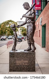 BOSTON, USA - SEPTEMBER 1: Famous Monument of Red Sox Baseball player Ted Williams located in front of the Fenway Park Stadium in Boston, Massachusetts, USA on September 1, 2013.