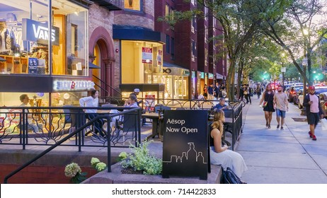 BOSTON, USA - SEPTEMBER 11: Panoramic view of the iconic Newbury Street in Boston, MA, USA with its expensive stores and restaurants and lots of locals and tourists shopping on September 11, 2017.