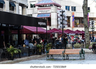 BOSTON, USA - SEPTEMBER 29, 2017: The open spaces of Quincy Market are a common venue for various street performers and restaurants.