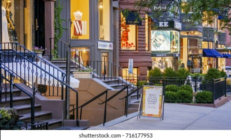 BOSTON, USA - SEPTEMBER 4: The architecture of Newbury street in Boston, MA, USA with its brimstone buildings turned into expensive fashion stores and fancy restaurants at nigh on September 4, 2017.