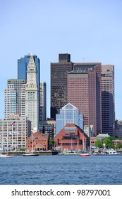 Boston waterfront view with urban city skyline and modern architecture over sea.