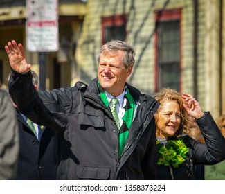 Boston,MA - 3/17/19: Massachusetts Governor Charlie Baker and wife Lauren march with other politicians in the St Patrick's Day Parade