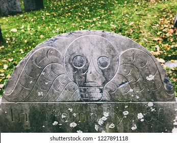 Boston,Massachusetts,United States.October 30th,2018.A skull pattern on a gravestone in The Old Granary Burying Ground in Massachusetts is Boston's third-oldest cemetery, located on Tremont Street.