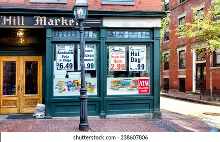 BOSTON-MAY 30, 2010: Old fashioned corner grocery store in the historic Beacon Hill neighborhood, where buildings and sidewalks are still constructed of red brick and a gas street lamp flickers.