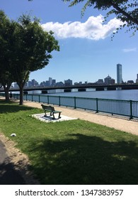 Boston's Charles River on a clear summer day along the City's bike path near the water, including the Boston skyline.