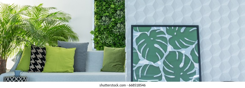 Botanic design of cozy lounge in grey and green colors