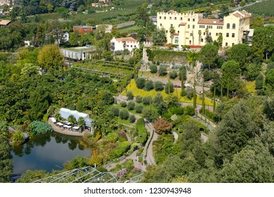 The botanical garden of Meran from above with the castle and the pond