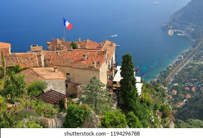 Botanical garden and village of Eze, with various cacti on foreground, aerial view of French Riviera, Europe