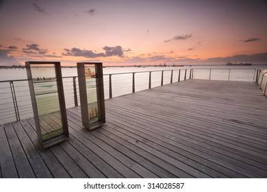 BOTANY BAY, AUSTRALIA - AUGUST 16, 2015; Sunset over Botany Bay from the timber jetty pier, at the place where Captain Cook landed in  Sydney Australia