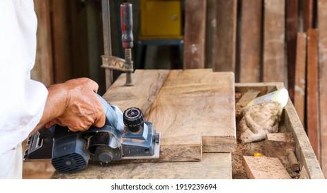 Botelhos, Minas Gerais - Brazil - February 11 2021: carpenter carving wood