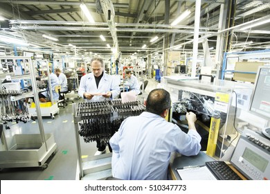 Botevgrad, Bulgaria - August 23 , 2016:  Workers near machine in a factory for manufacture  of sensors and controls