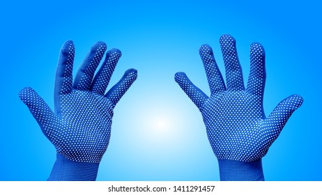 Both Hands in Blue Gloves with White Dotted Pattern Isolated on Blue Background