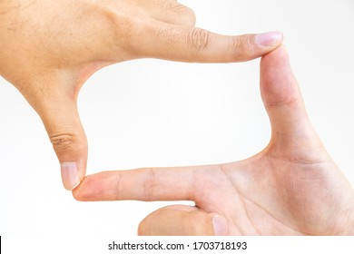 Both hands of a man making a frame with fingers