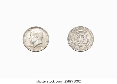 Both sides of an old US half dollar, isolated on a white background.