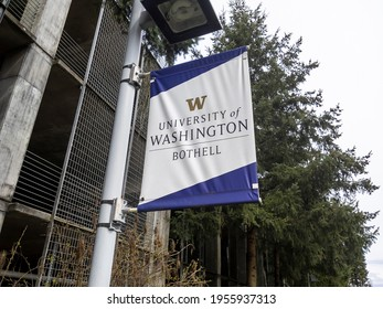 Bothell, WA USA - circa April 2021: Low angle view of a University of Washington Bothell banner on a pole outside the parking garage.