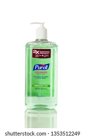 BOTHELL, WA/USA- March 29, 2019: Purell hand sanitizer in larger plastic bottle isolated on white background with reflection