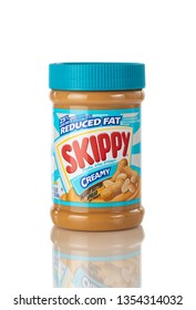 BOTHELL, WA/USA- March 30, 2019: Skippy Peanut butter in plastic bottle isolated on white background with reflection