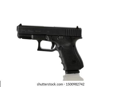 BOTHELL, WA/USA- September 10, 2019: Glock logo on 40 caliber pistol isolated on white background with reflection