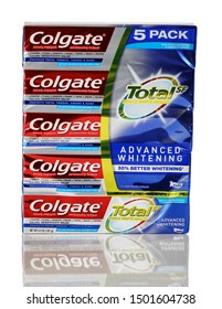BOTHELL, WA/USA- September 11, 2019: Colgate toothpaste logo on boxed package isolated on white background with reflection