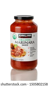 BOTHELL, WA/USA- September 16, 2019: Jar of Kirkland signature spaghetti sauce isolated on white background with reflection