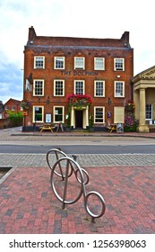 Botley, Hampshire / England - 8/15/2018: The Dolphin Hotel is a long established Georgian building, situated in the historic village of Botley. A modern stylish bike stand is in the foreground.