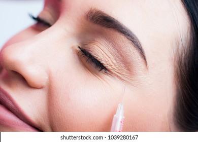Botox face, face model close-up, brunette girl