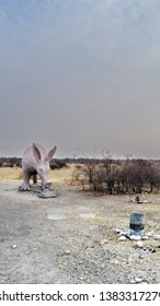 BOTSWANA - CIRCA SEPTEMBER 2012: Statue of an aardvark at the entrance to a campground in the bush at sunset
