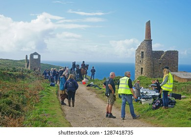 Bottalack, near St Just, Cornwall, August 17th, 2015, actors, film crews and support staff talk and socialise betweeh shooting scenes for the BBC TV series Poldark